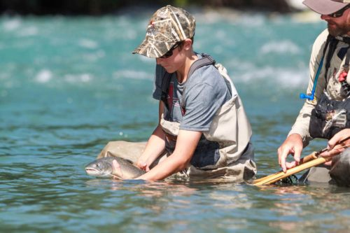 Kid Releasing a nice bull trout