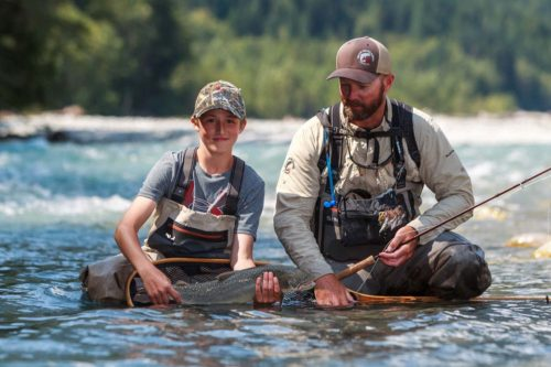 boy with a bull trout