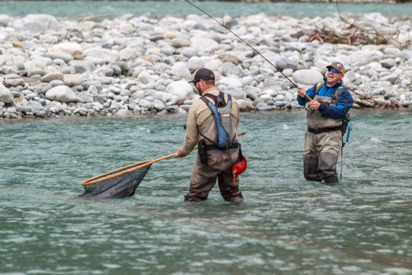 netting a big bull trout near Whistler BC