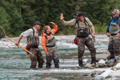 high fives after catching a big fish