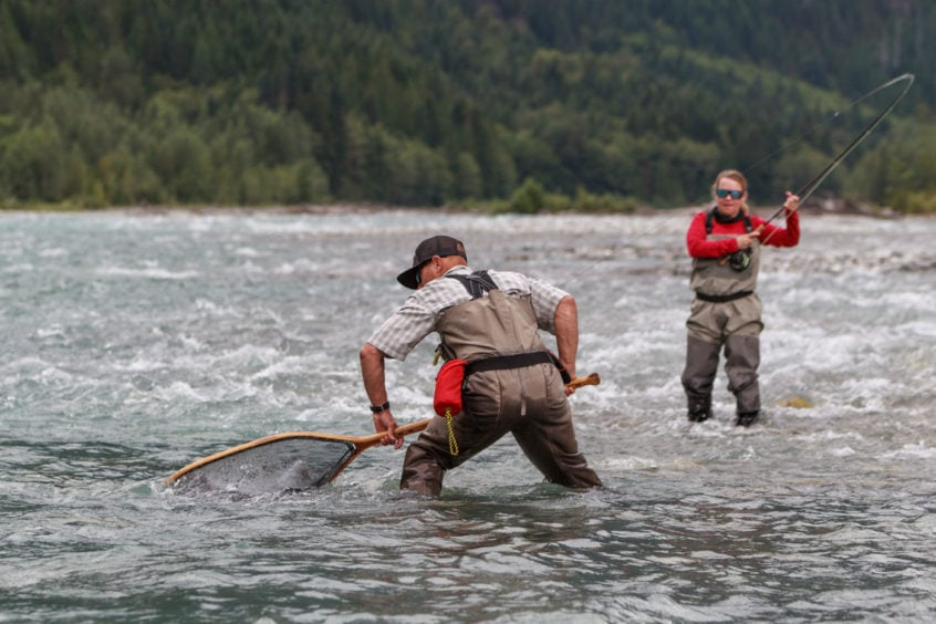 using a moby net to land a big bull trout